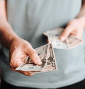 paying cash at a flea market