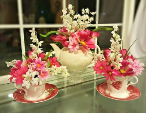 This teapot flower arrangement is an easy DIY gift idea or centerpiece for a party. Follow our step by step directions to create one today.