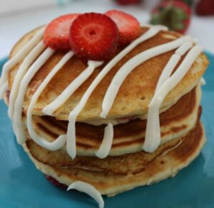 Strawberry Pancakes with Cream Cheese Glaze - By Thrifty Jinxy