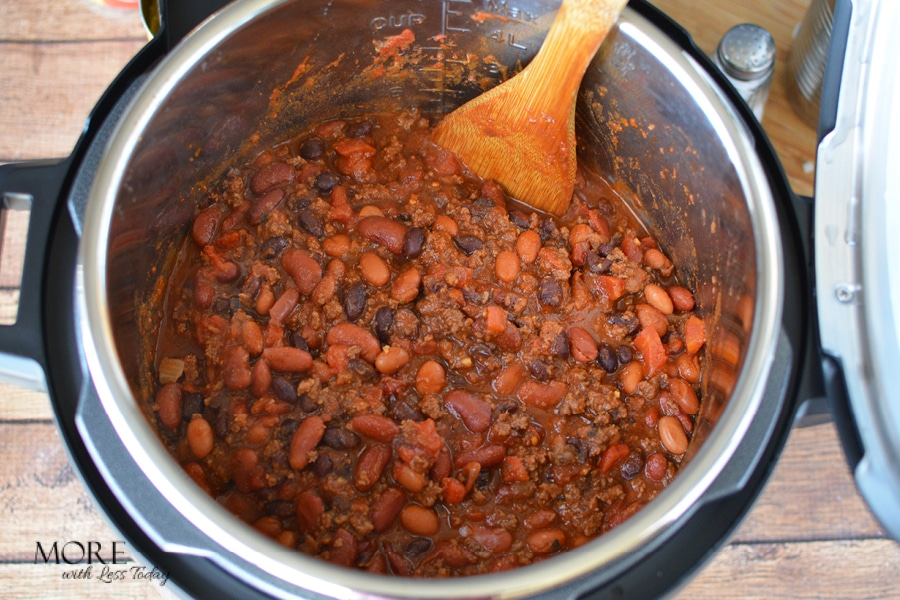 stirring chili recipe in an Instant Pot