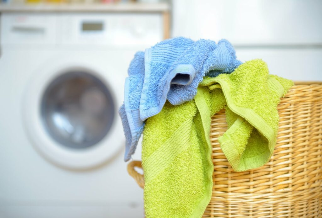 dirty towels in a laundry basket - genius uses for table salt