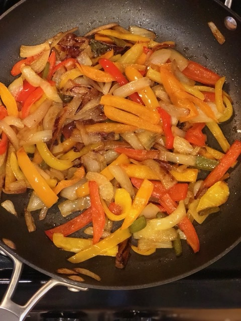 Cooking Steak in Your Cast Iron Skillet with Peppers