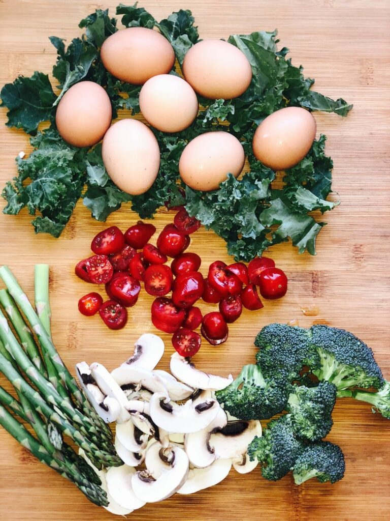photo of eggs, tomatoes, asparagus, broccoli and mushrooms for frittata recipe