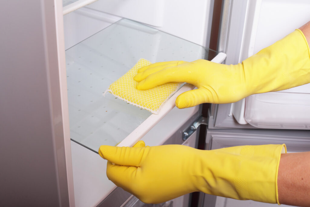 photo of rubber gloves cleaning a dishwasher