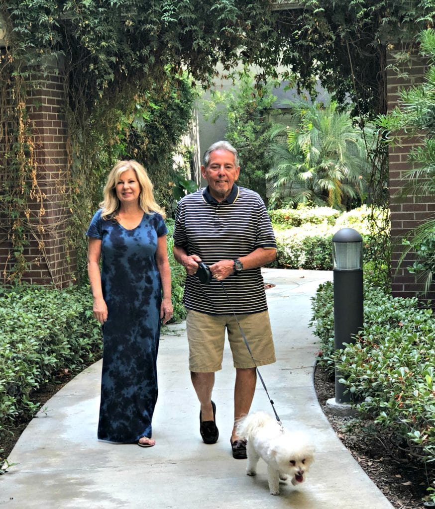 Lori Felix empty-nester walking dog with husband