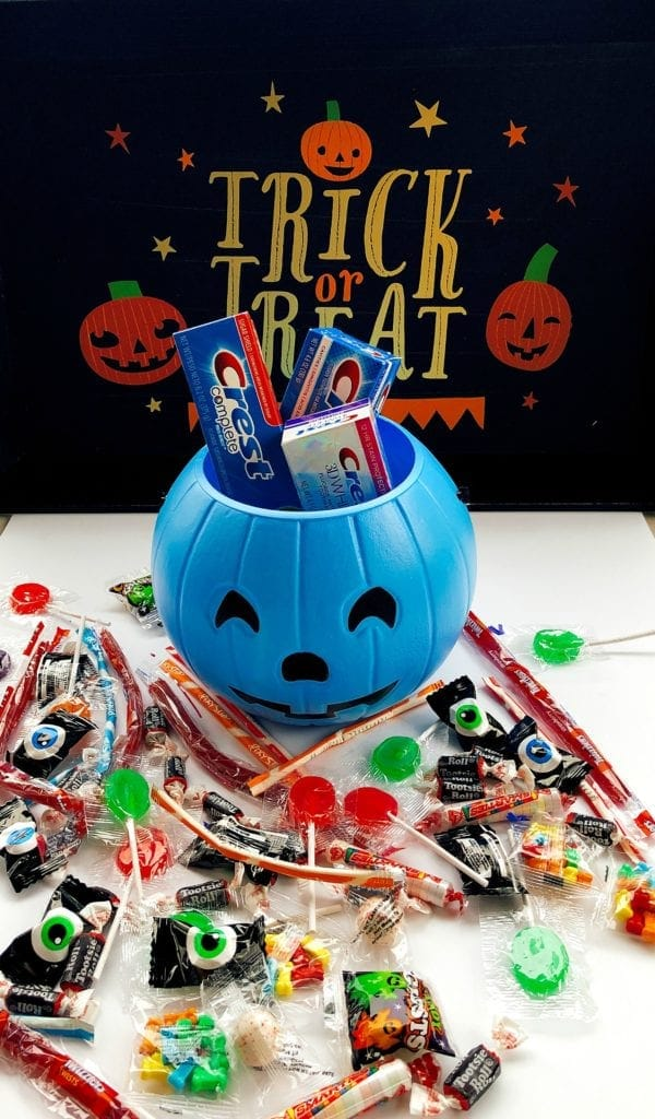 Crest blue pumpkin with Halloween candy and Crest toothpaste