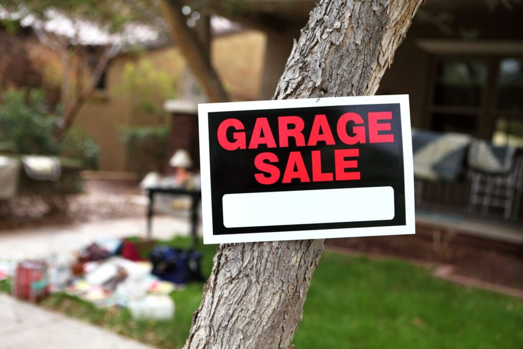 Garage Sale sign posted to a tree