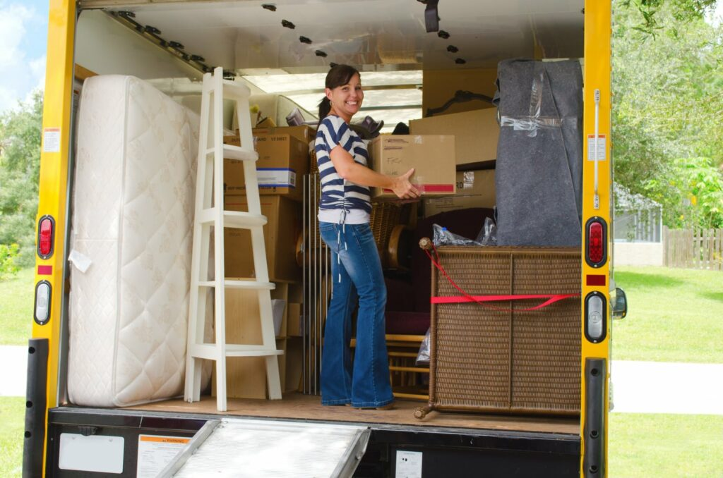 packing a moving truck with boxes and a bed
