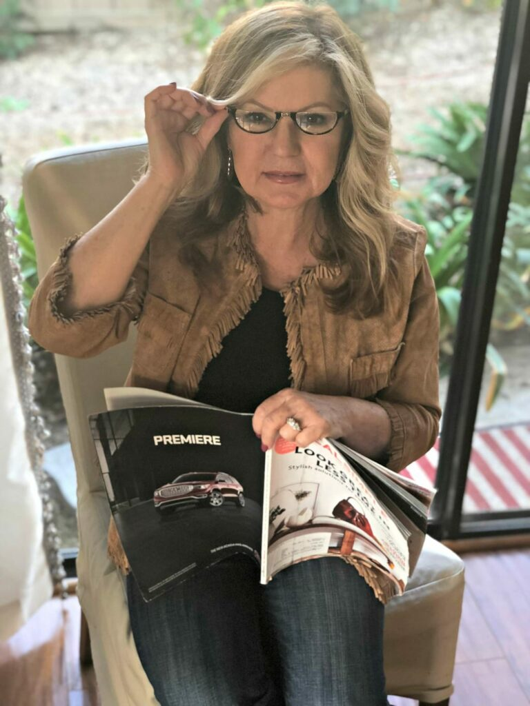 Lori Felix reading a magazine with Neckglasses
