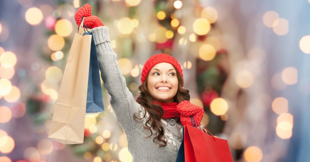 woman happily shopping during the holidays