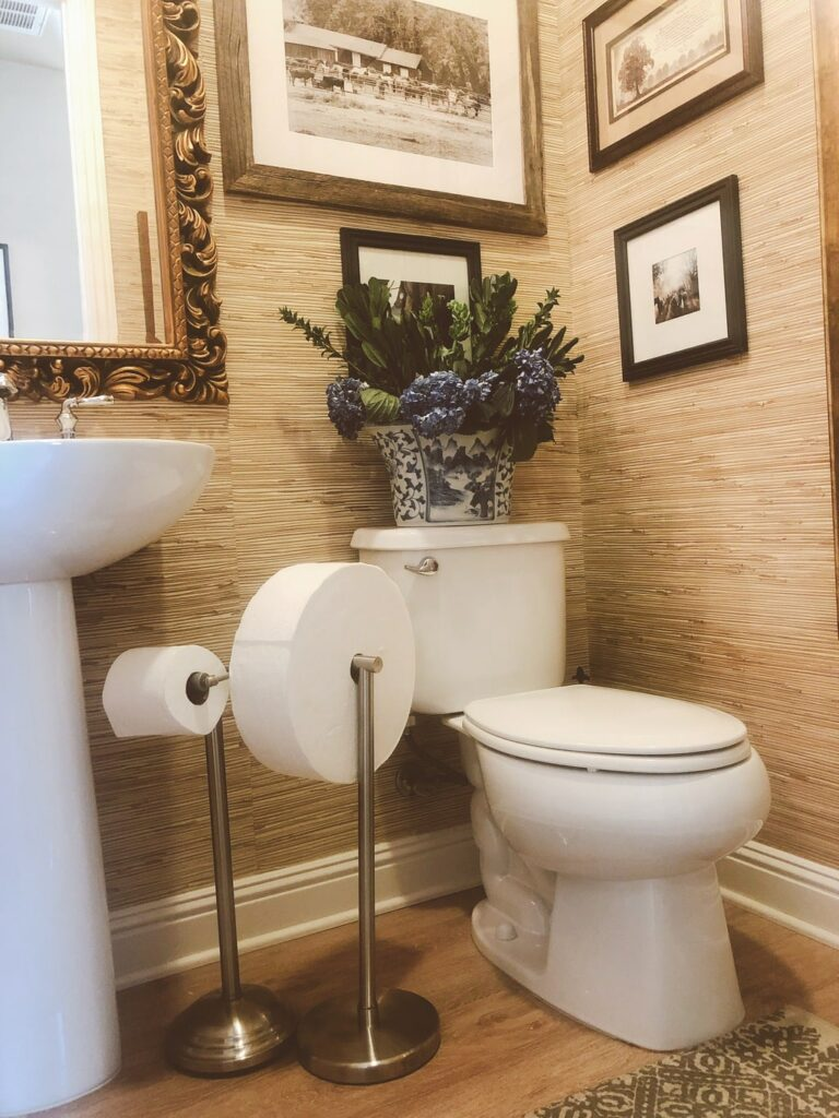guest bathroom pictured with Charmin Forever Roll and regular roll