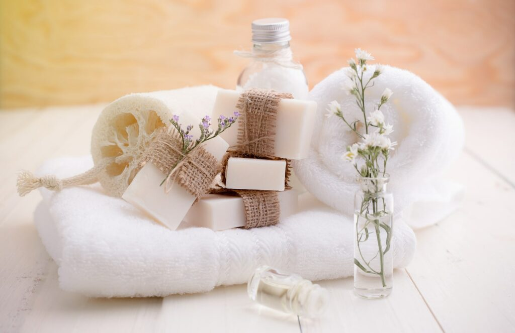 photo of decorative soaps, loofah and towels