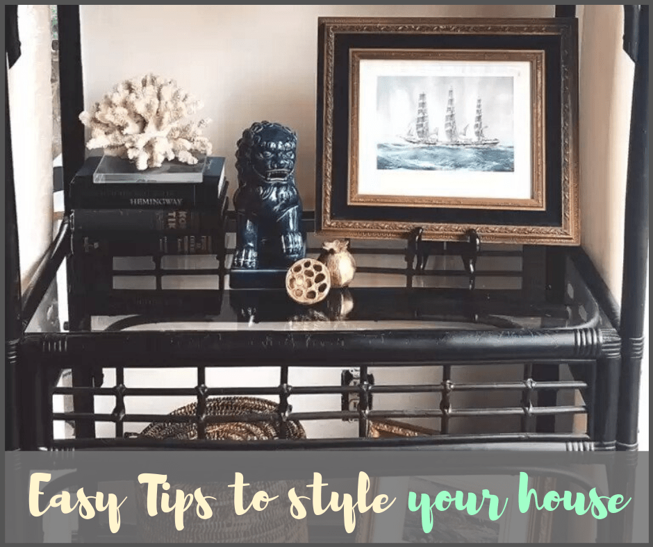 how to style a shelf with images of books and decorative items