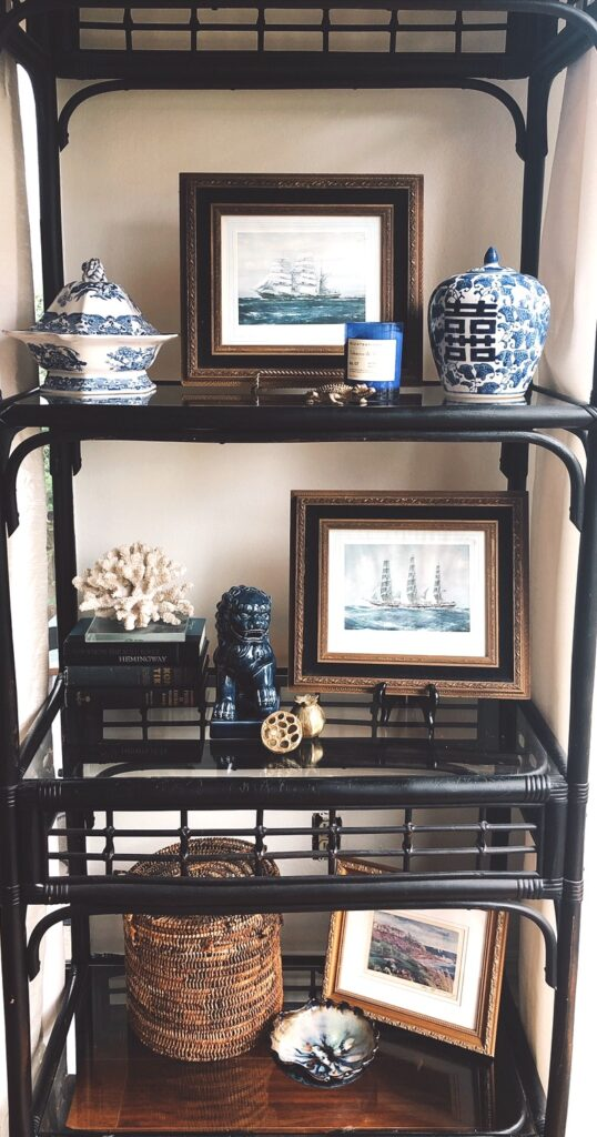 shelves decorated with blue and white objects small photos baskets and books