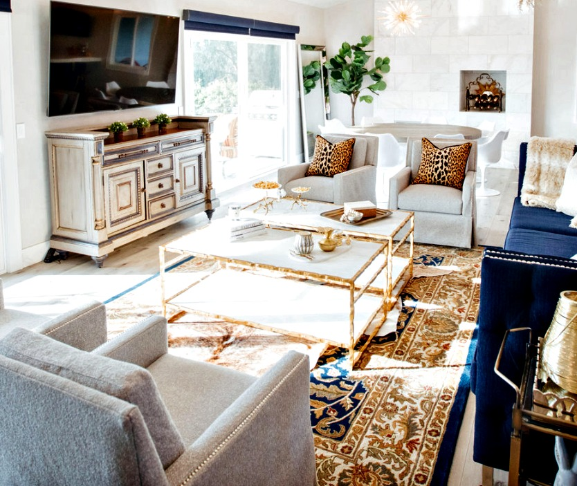 living room decor with leopard pillows a gold coffee table and modern furniture
