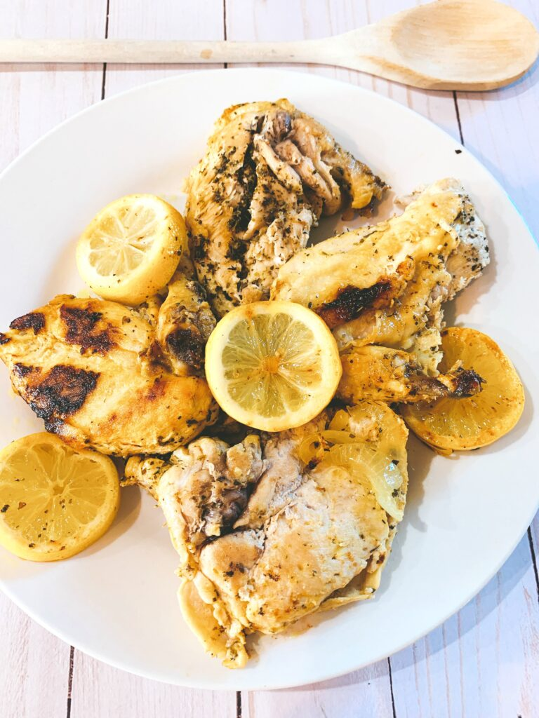 adding lemon slices to Instant Pot Lemon Chicken Recipe