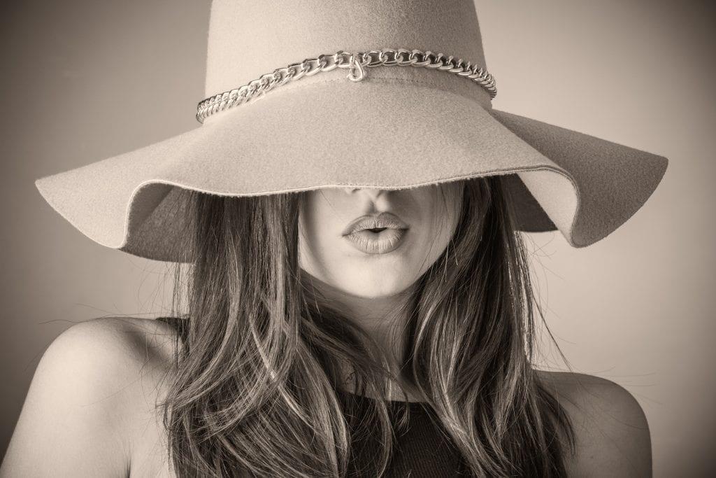 woman in floppy felt hat