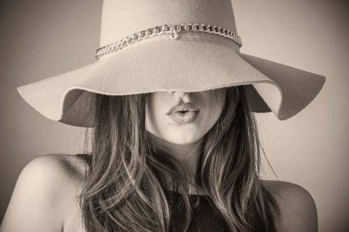 woman in floppy felt hat