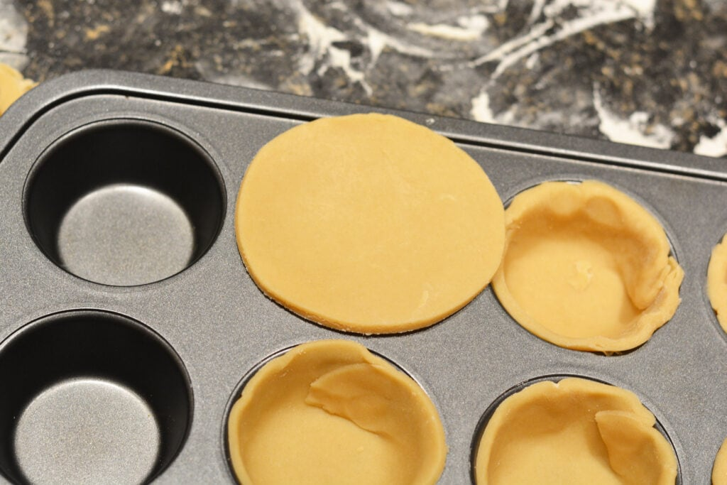 Muffin tin with pie crust for mini apple pies