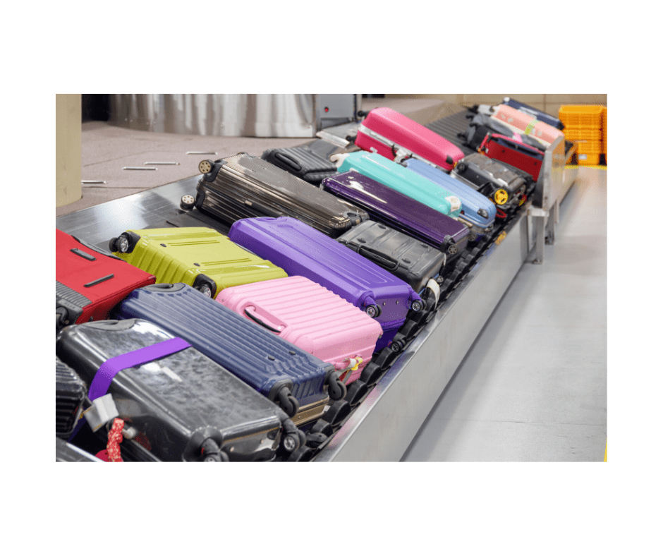 colorful suitcases on airport conveyer belt