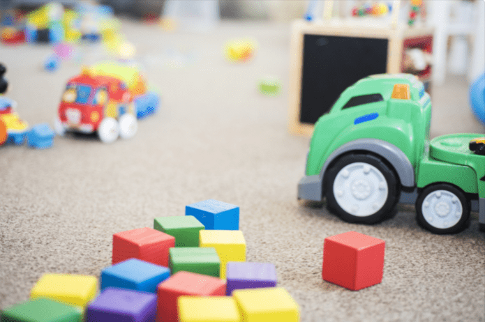 colorful kids blocks and toys on the rug