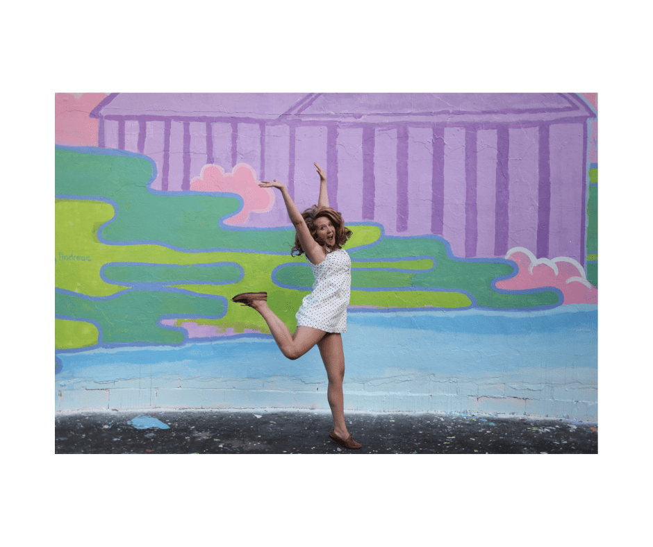 woman jumping for joy with a colorful watercolor background