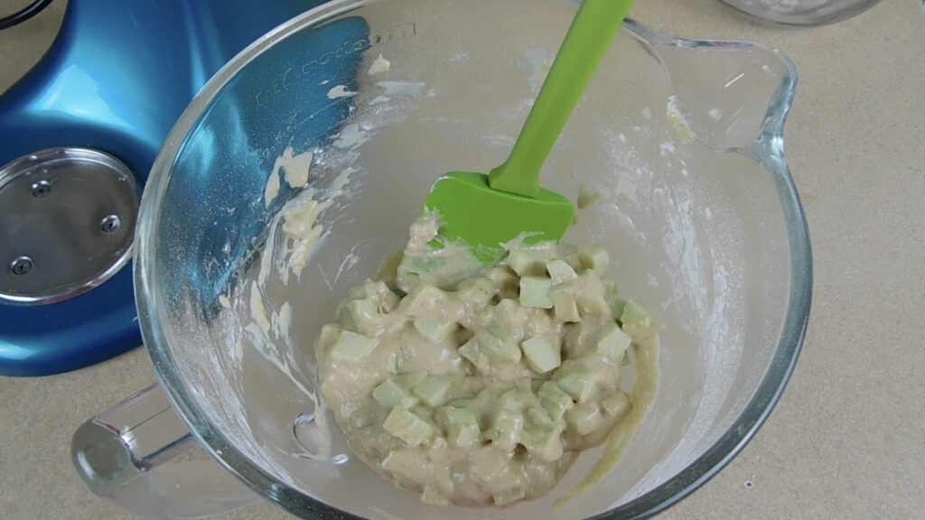 Sirring the apples and lemon juice for Homemade Apple Fritters Recipe with a Sweet Vanilla Glaze