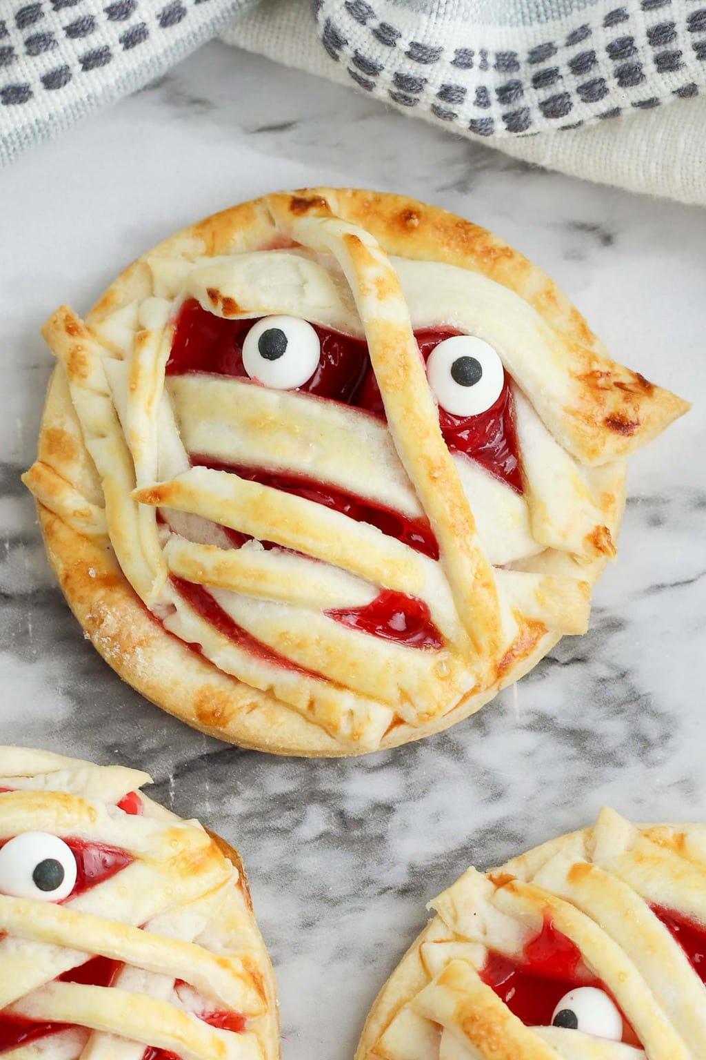 Halloween Desserts - Mummy Cherry Hand Pies recipe